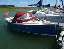 Clam 19 moored with sprayhood up