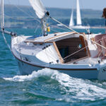 Adventure 19 sailing with spinnaker up