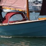 Shrimper 17 sailing with spray hood up